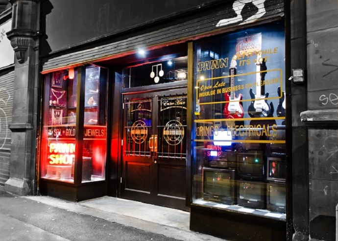 Neon lights and second hand items disguise Manchester's secret bar Dusk Til Pawn as a regular pawn shop