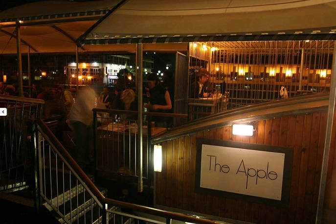 The exterior of The Apple barge bar in Bristol floating on the water