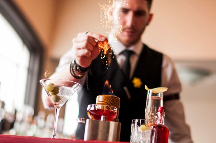 Close up of a bar tender mixing a drink at the bar of The Daffodil in Cheltenham