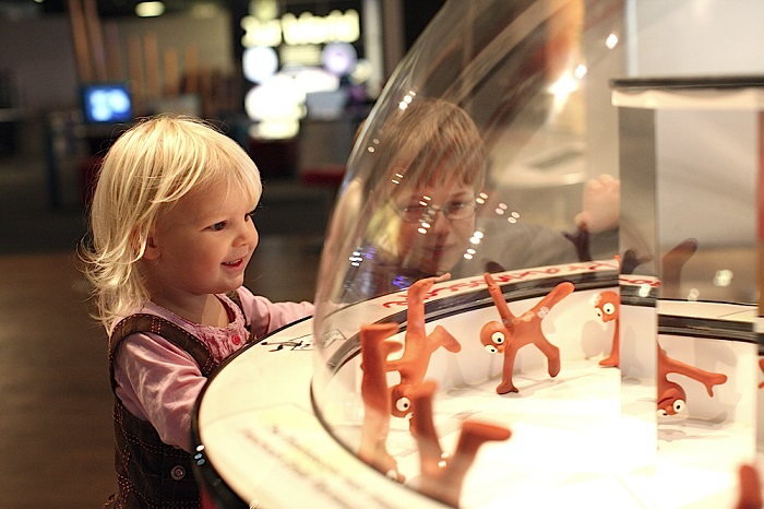 Boy and girl looking at a Praximoscope in the At Bristol Science Centre