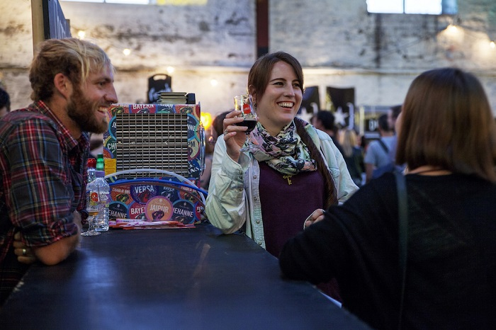 lady with beer in hand chatting to friends at Bristol Craft Beer Festival