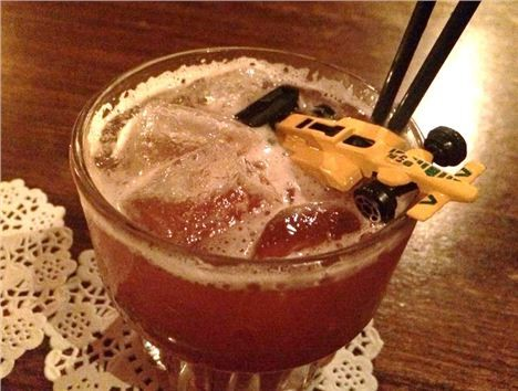 A yellow toy car adorns a cocktail at the Under New Management bar in Manchester
