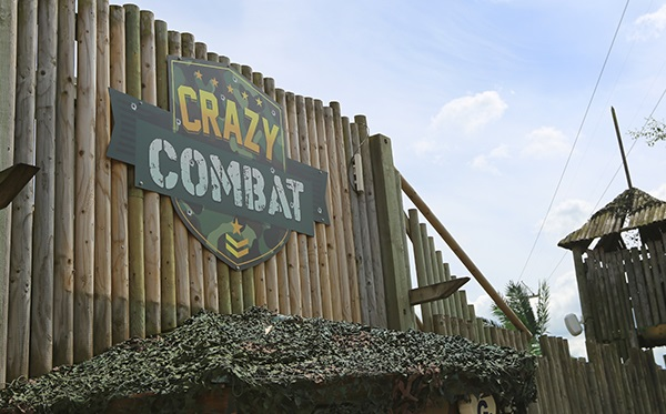 The crazy combat attraction at Flamingo Land, York, is multi-level with a sniper tower and wooden barricades.