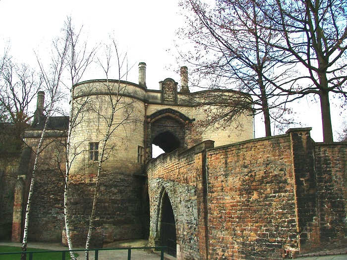 The Gatehouse at Nottingham Castle where the old Medieval wall meets the curved towers on the newer 17th century building, surrounded by bare trees