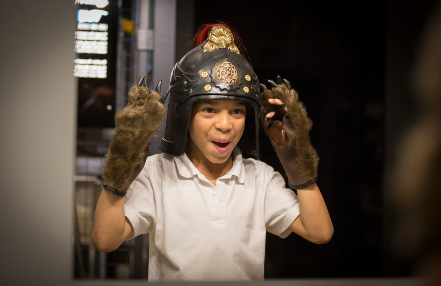 A family day out to the Royal Shakespeare Theatre is sure to include dressing up! Here a small boy is dressed in bear gloves and roman helmet, and is clearly loving it!