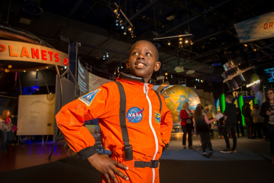 Entertain your inner space person like this young chap in his orange NASA space gear on a day out at the National Space Center in Leicester