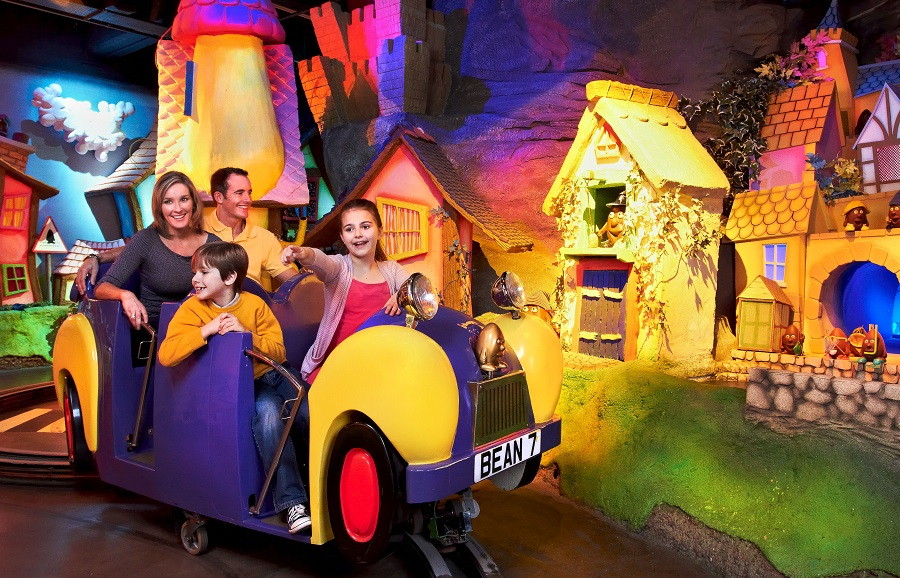 A family enjoying a colourful ride at Cadbury World in York