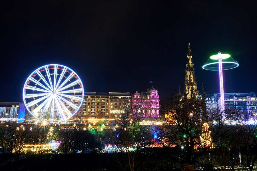 The Christmas Market in Edinburgh features some amazing rides, and beautiful coloured lights alongside the traditional stalls that line the streets.