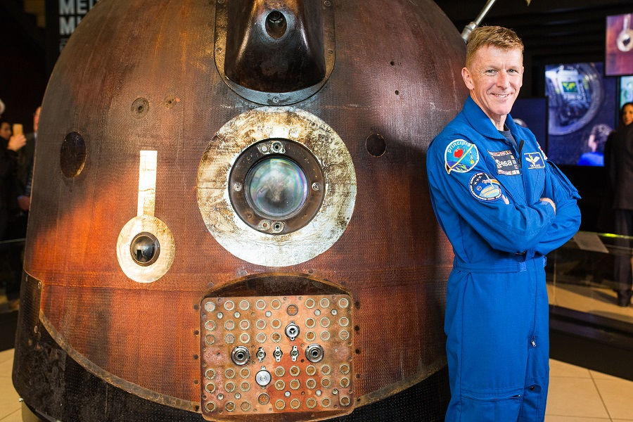 Astronaut Tim Peake poses in uniform next to the Soyuz TMA-19M descent module spacecraft at the Shildon Locomotion Museum close to Darlington