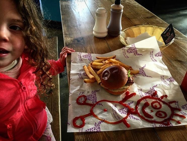 A stick man drawn with red ketchup and a tasty burger, this little girl loves the Number 1 burger place in Wales!