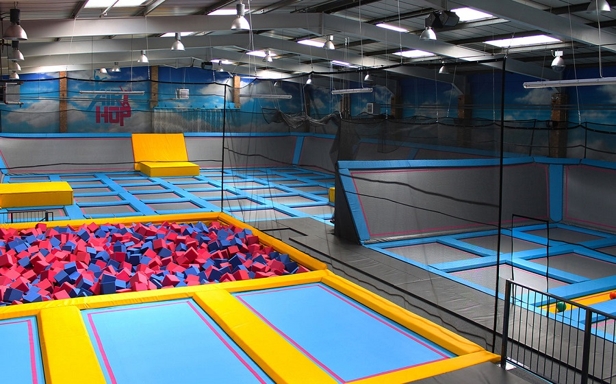 AirHop's Main Court is huge with 50 interconnected trampolines that go across the floor and up the walls, plus a pit of red and blue foam cubes to jump into.