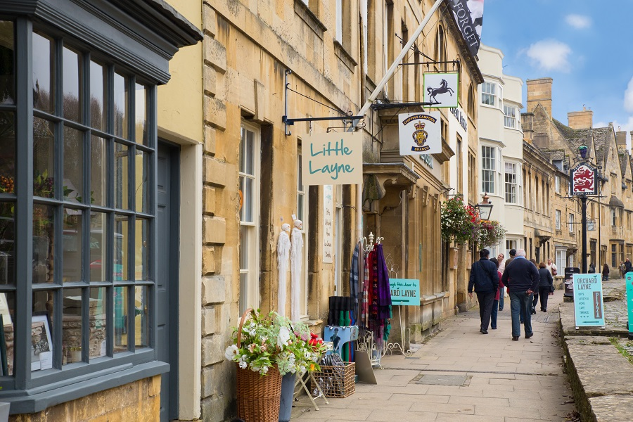 Yellow-stoned buildings line the streets of Chipping Campden, as people wander through one of the most romantic cities in England.
