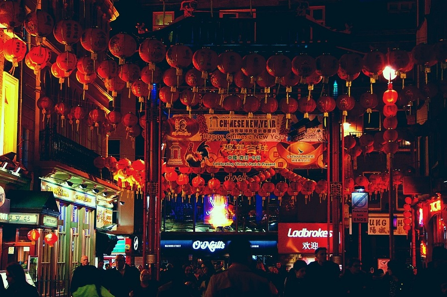 decked out for the New Year, China Town looks resplendent in its balloons and banners.