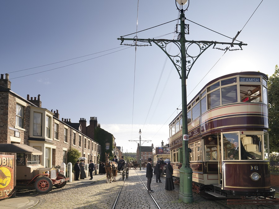 A group of people in Beamish Town, Durham about to board a tram.