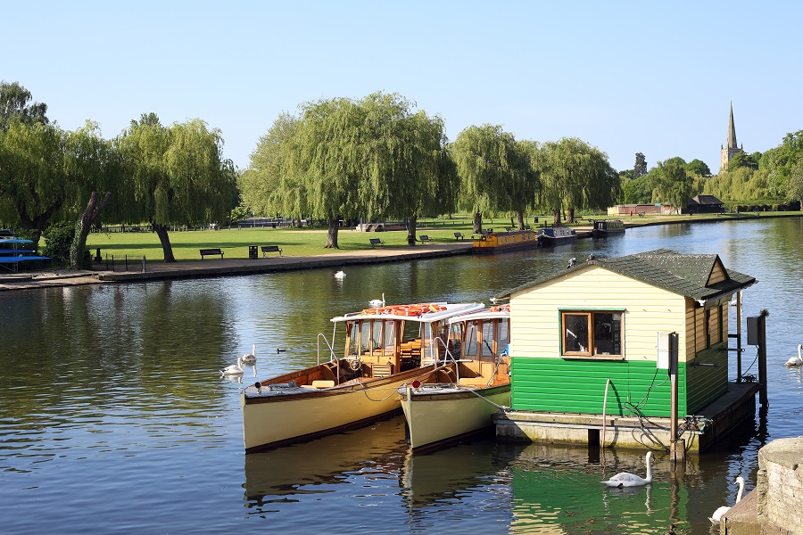 Two boats sit on the River Avon in Stratford.