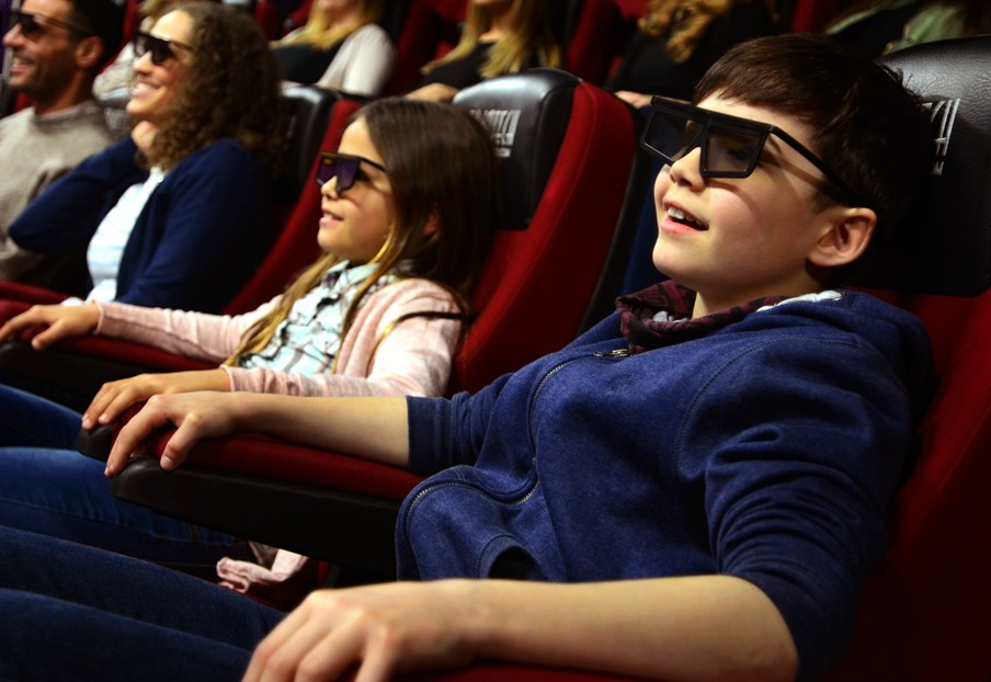 A family wearing 4D glasses at the 4D cinema zone at Cadbury World, Birmingham.