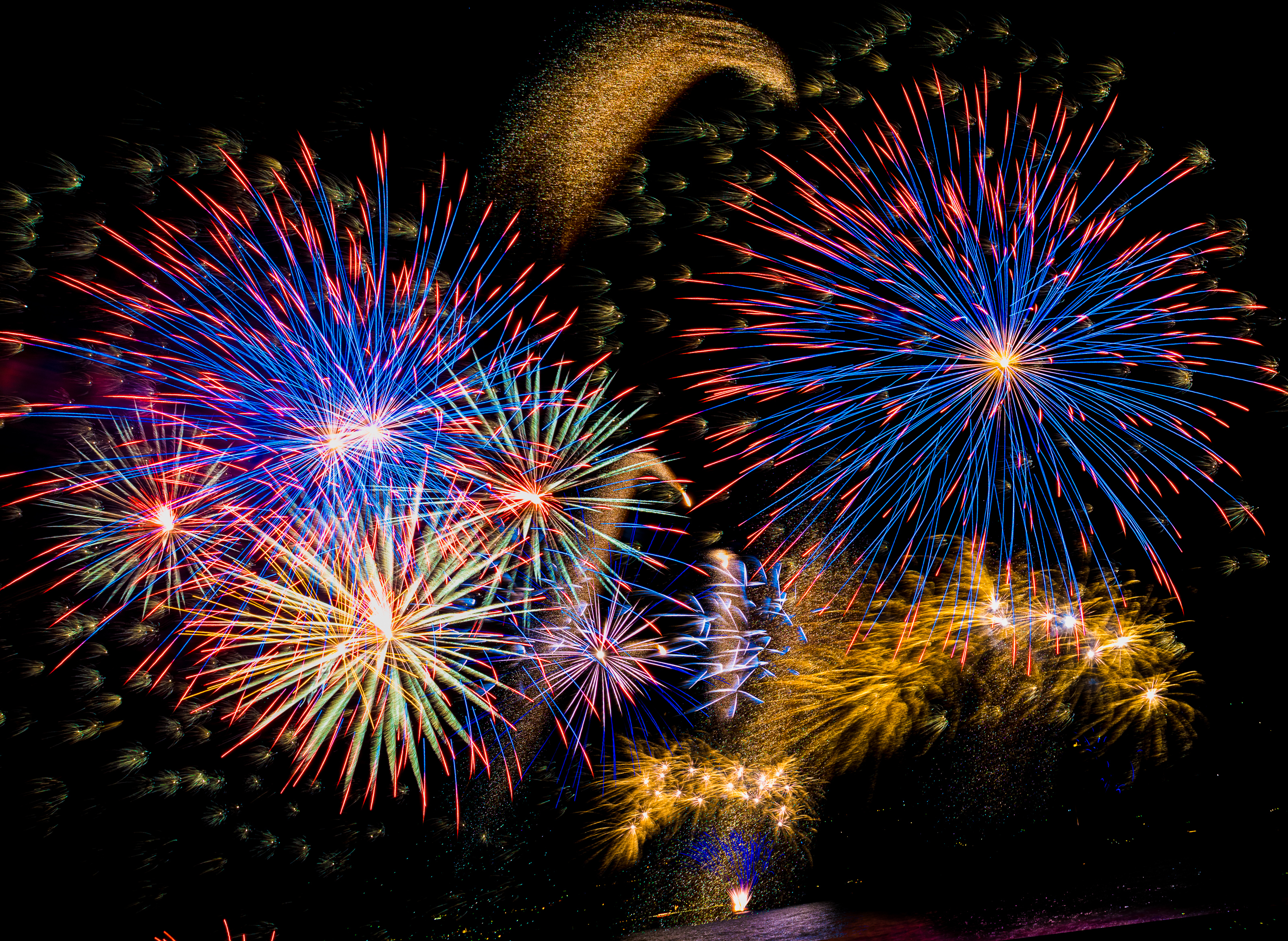 brightly coloured fireworks lighting up the night sky