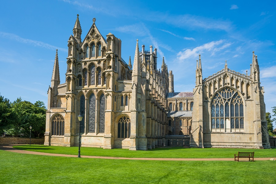 Ely Cathedral is a honey-coloured building with several spires and stained-glass windows. It's the starting point ok the UK ultra-marathon Monster Ultra.