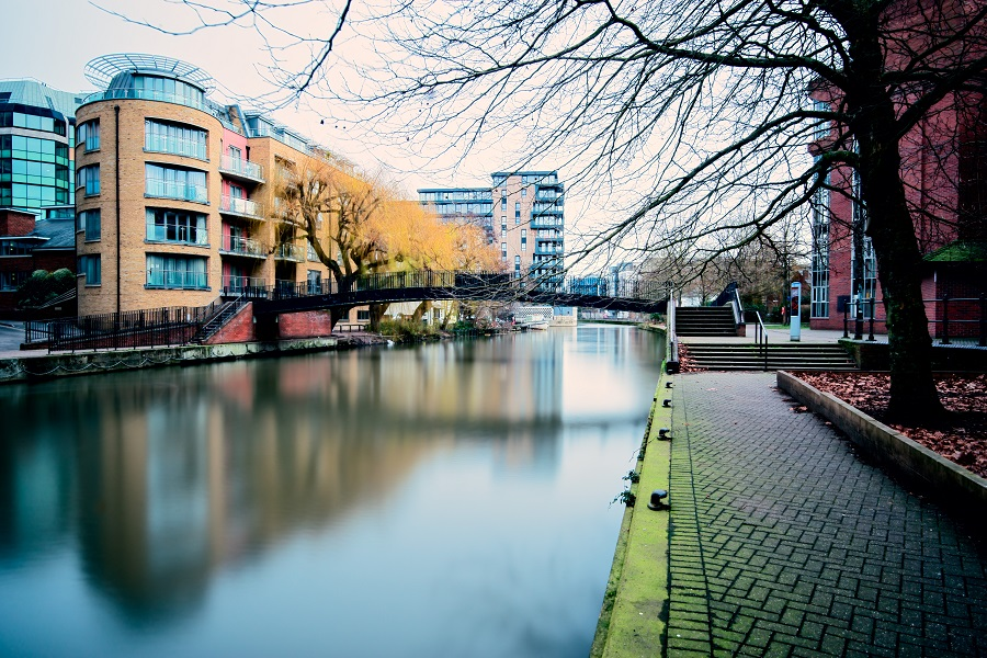 A river runs through past Reading city, part of the UK ultra-marathon route in Reading.