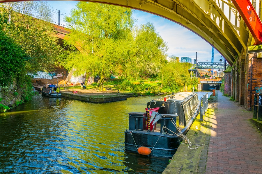 Canal barge parked up along the Manchester canals on a sunny day.