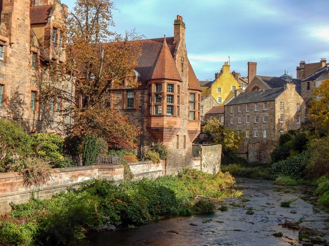 Autumnal shot of rustic buildings and river in Dean Village in Edinburgh, Scotland